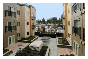 Photo of a courtyard at Savoy Lake City apartments.